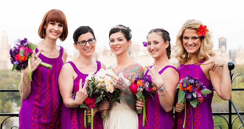 Tattooed bride at the Dakota in New York City with her bridesmaids
