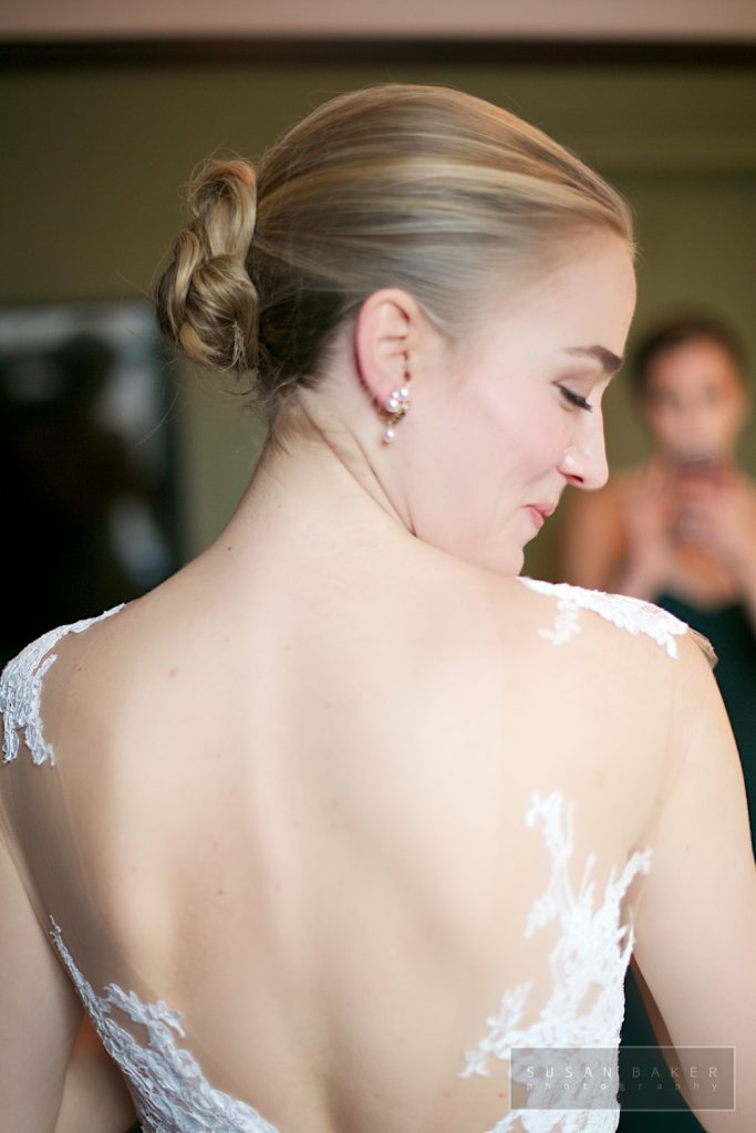 Bride in wedding gown and makeup open back