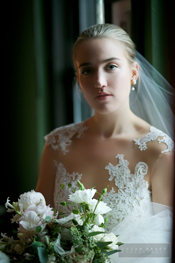 bride in wedding gown with makeup