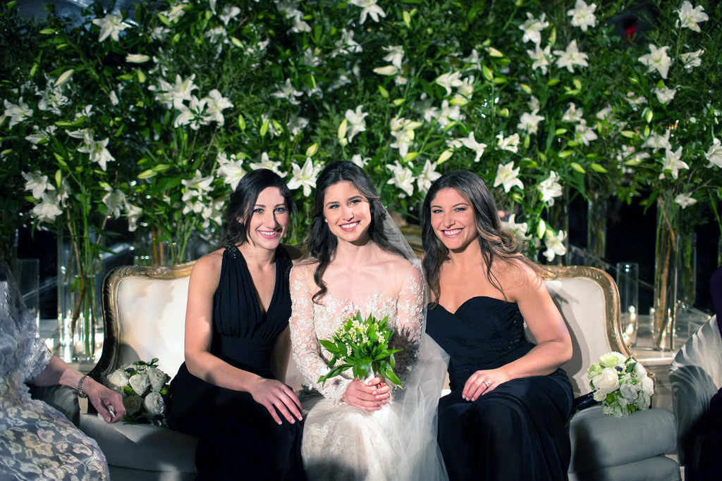 Beautiful bride and her two sisters photographed at the Plaza Hotel, New York City