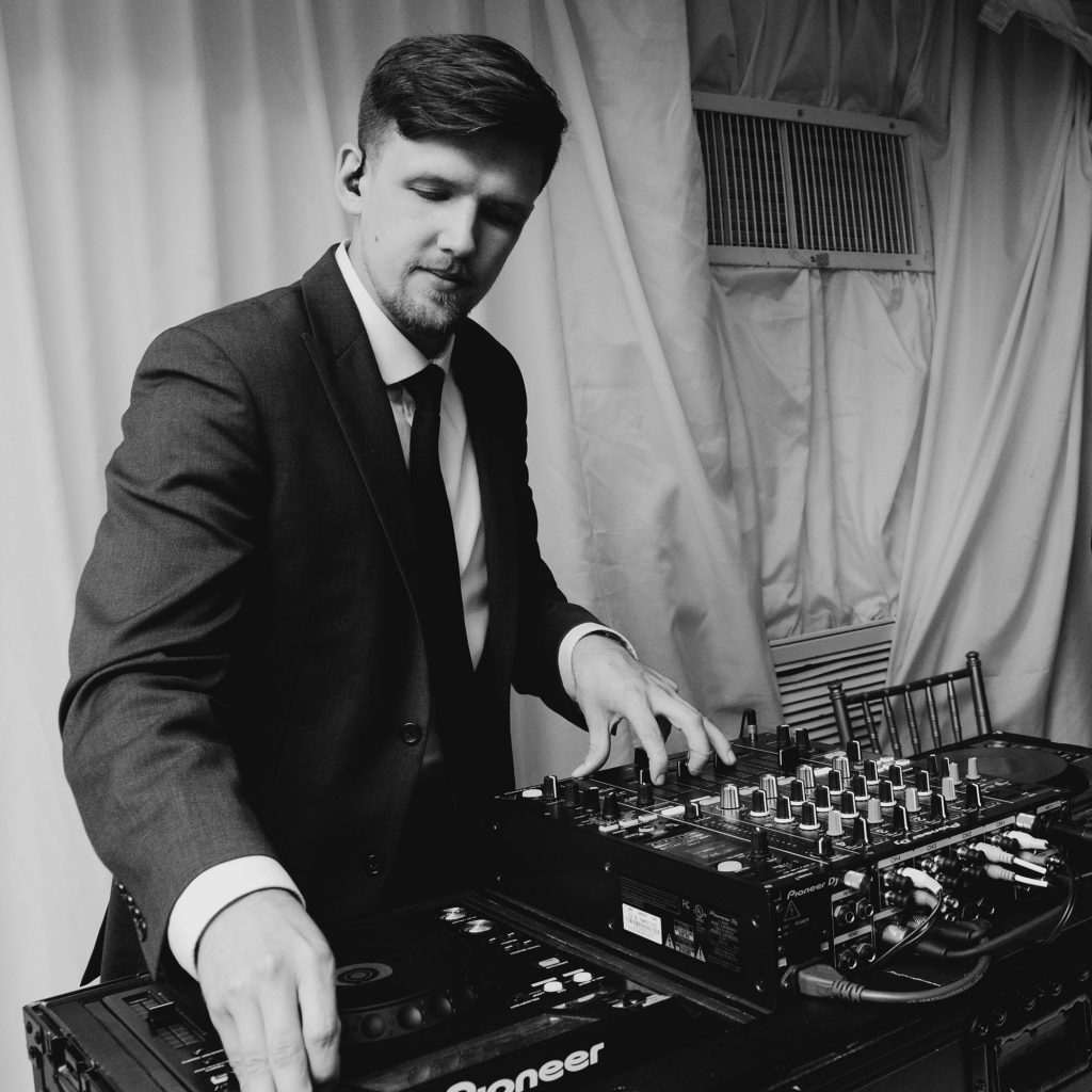 dj coolhand in action, mixer and gear in wedding tent