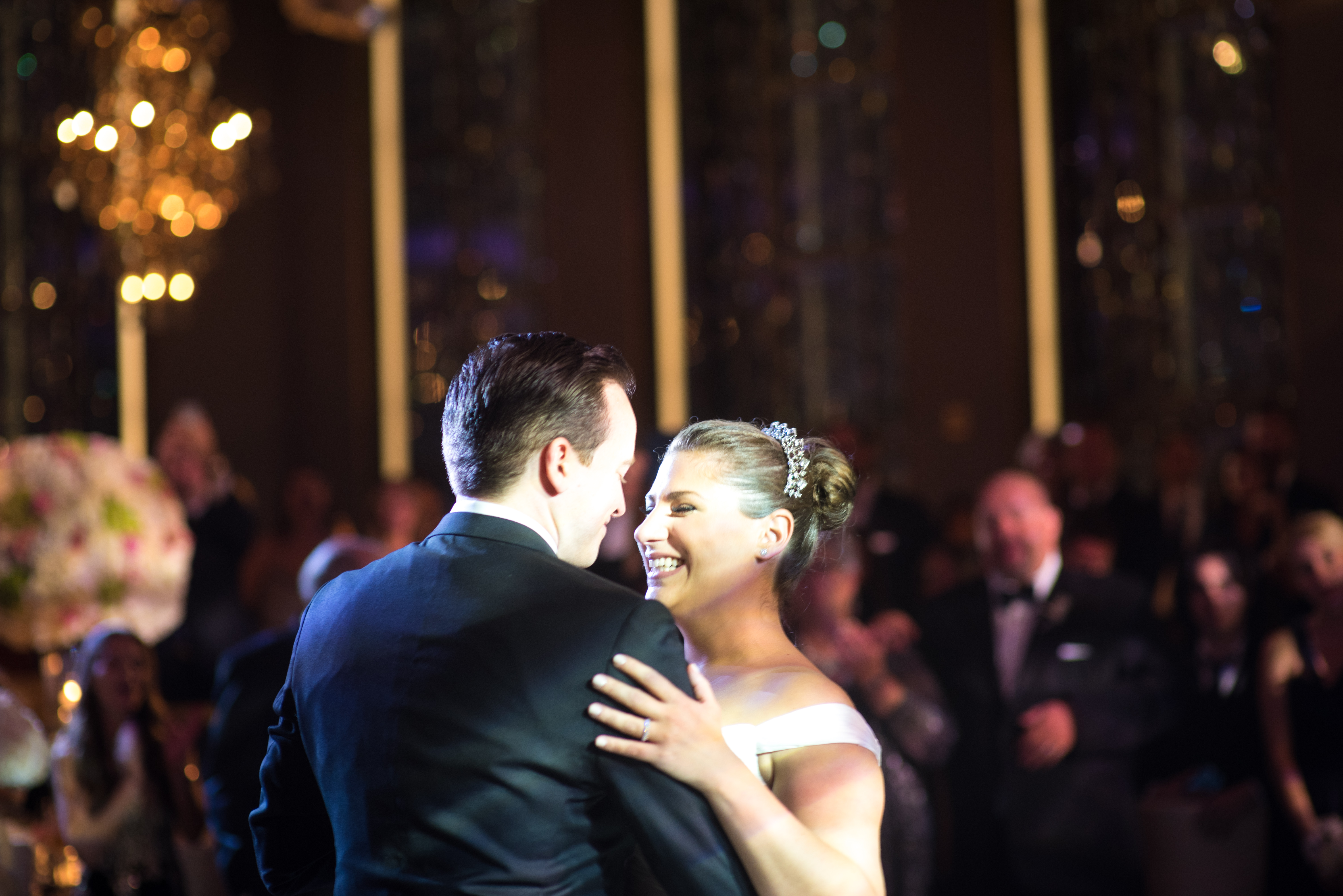 Modern bride with classic updo and tiara and groom dancing at the Rainbow Room in New York City