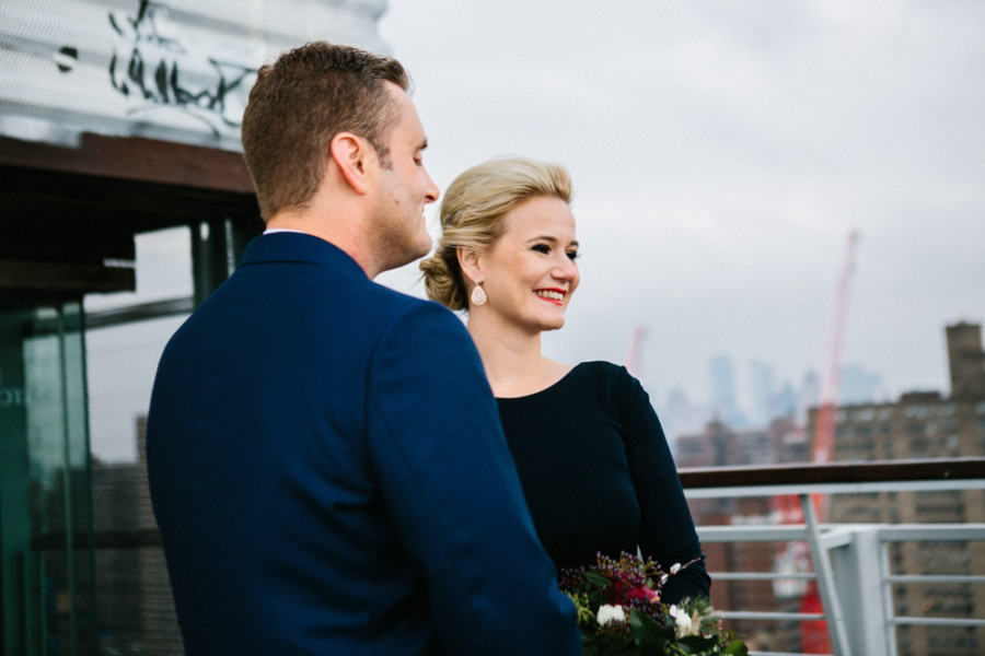 Blonde bride with chic updo and red lips at her elopement in the Lower East Side of New York City