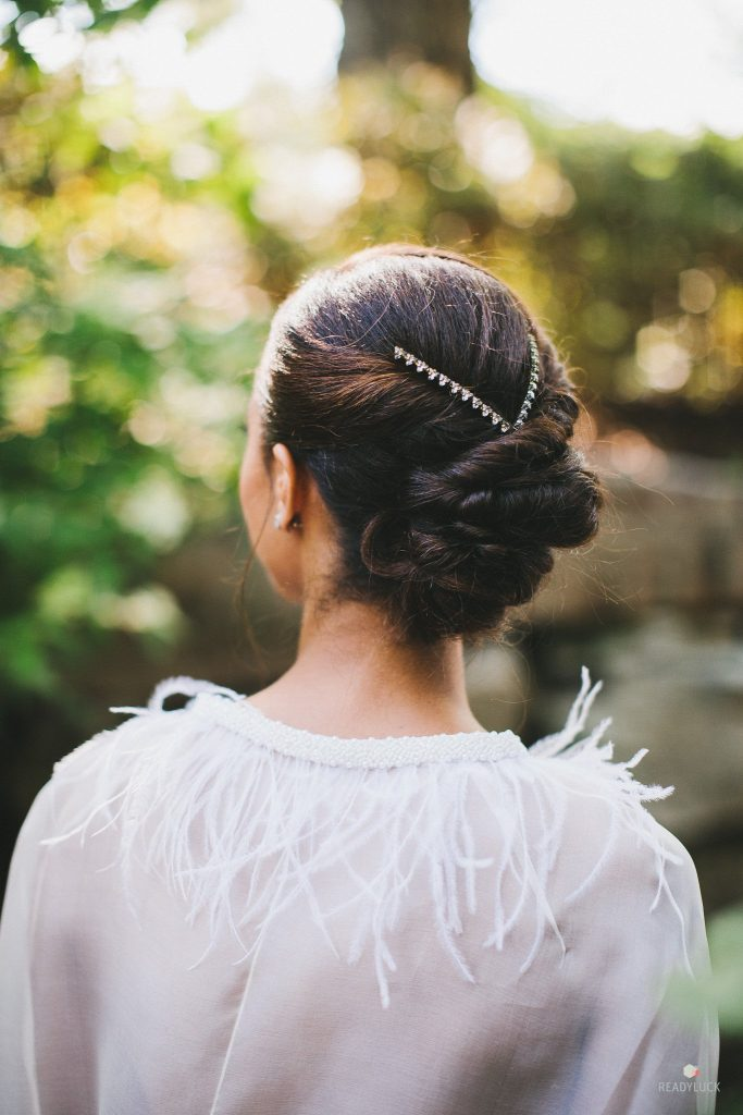 Bridal portrait closeup of updo hairstyle with jewels
