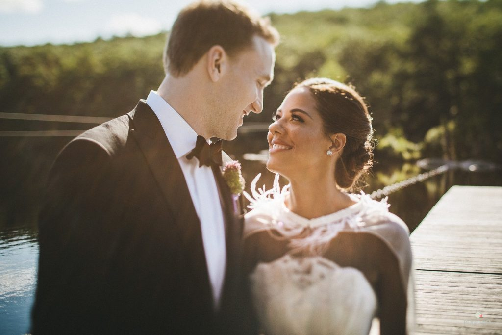 Bride and groom golden hour in countryside wedding
