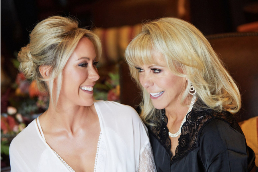 Mother and daughter share a moment before the wedding in Vail