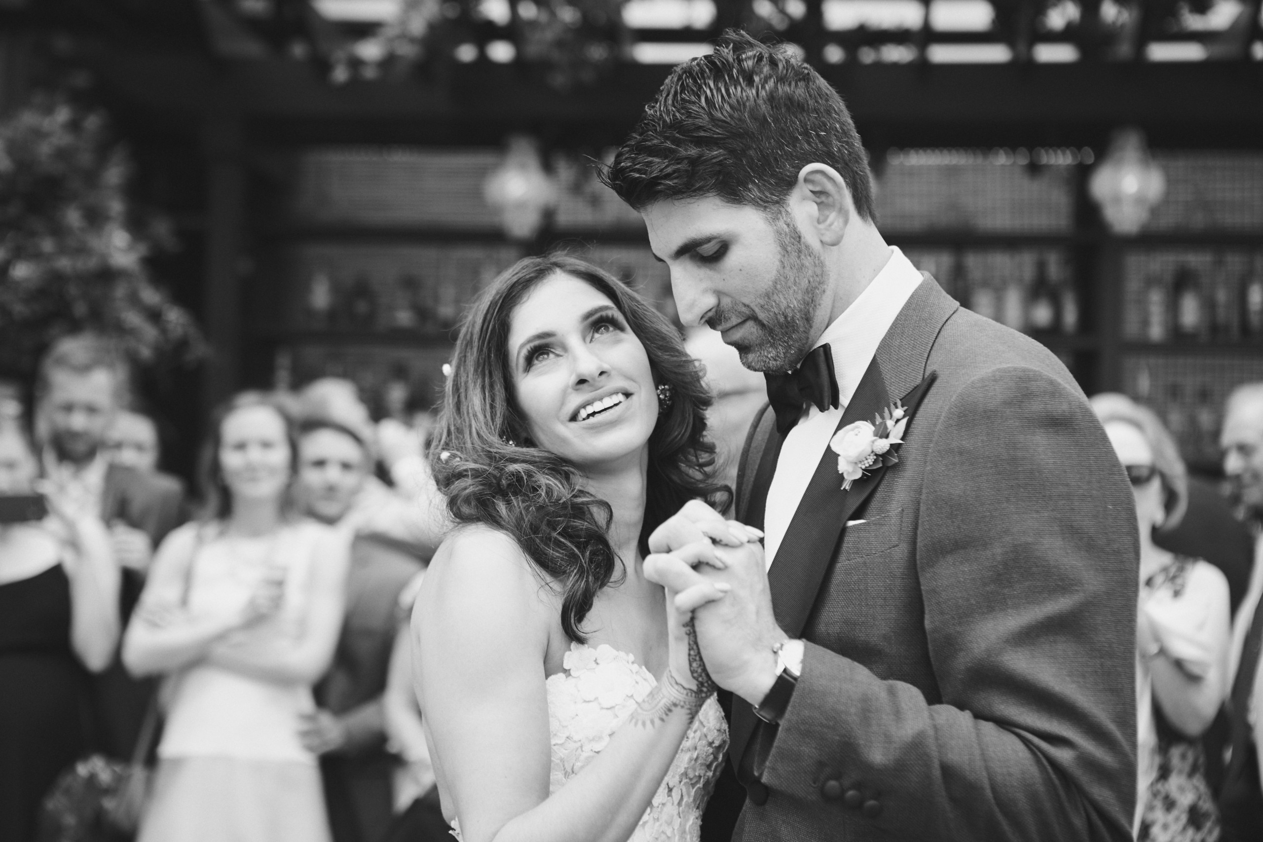 Black and white image of bride with long wavy hair and dramatic makeup dancing with groom at Gramercy Park Hotel in New York City