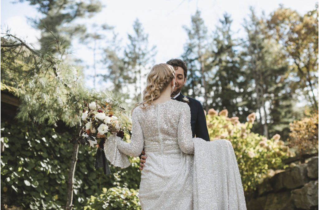 BRide and groom, wedding portrait with trees and flowers in the background