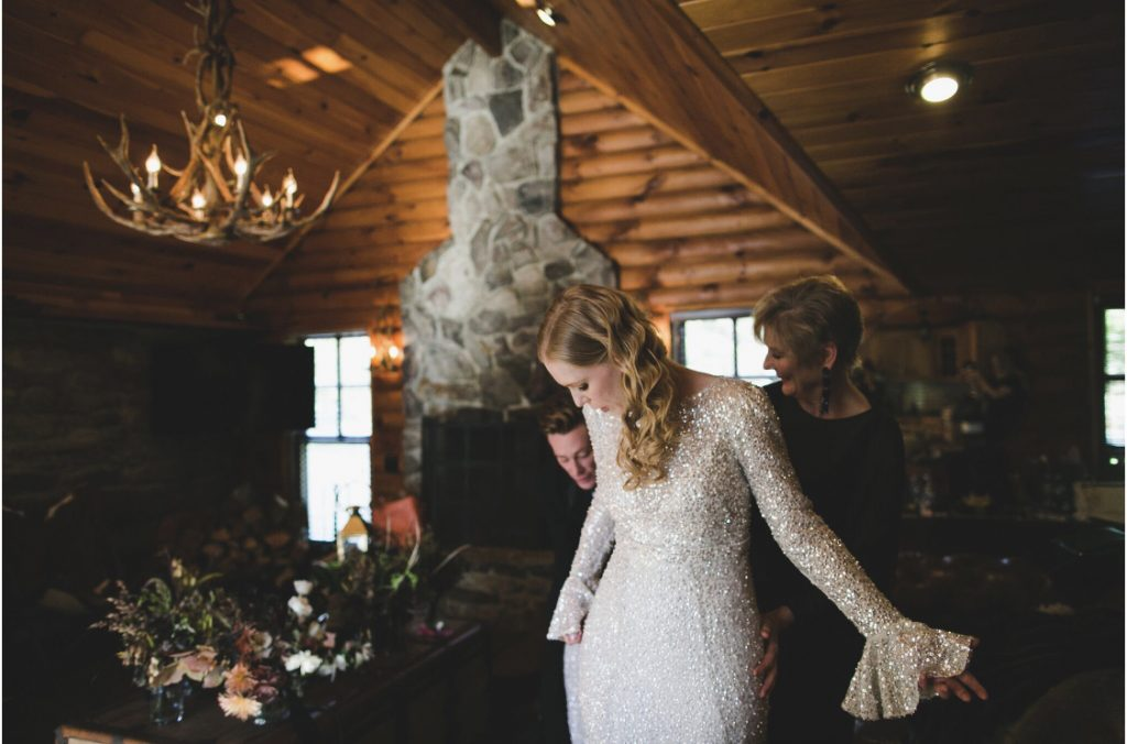 Bride with blonde waves, white sequined dress, cabininterior
