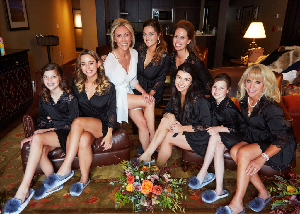 Bridal party - bride and family, in black prep gowns and fuzzy slippers