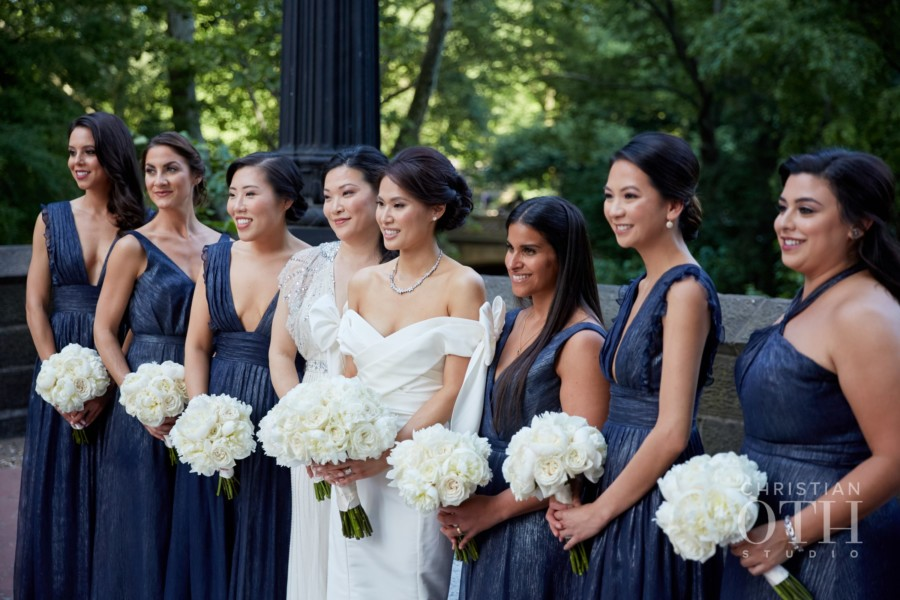 Beautiful Korean bride with her sister and bridesmaids pose in Central Park before wedding at Mandarin Oriental