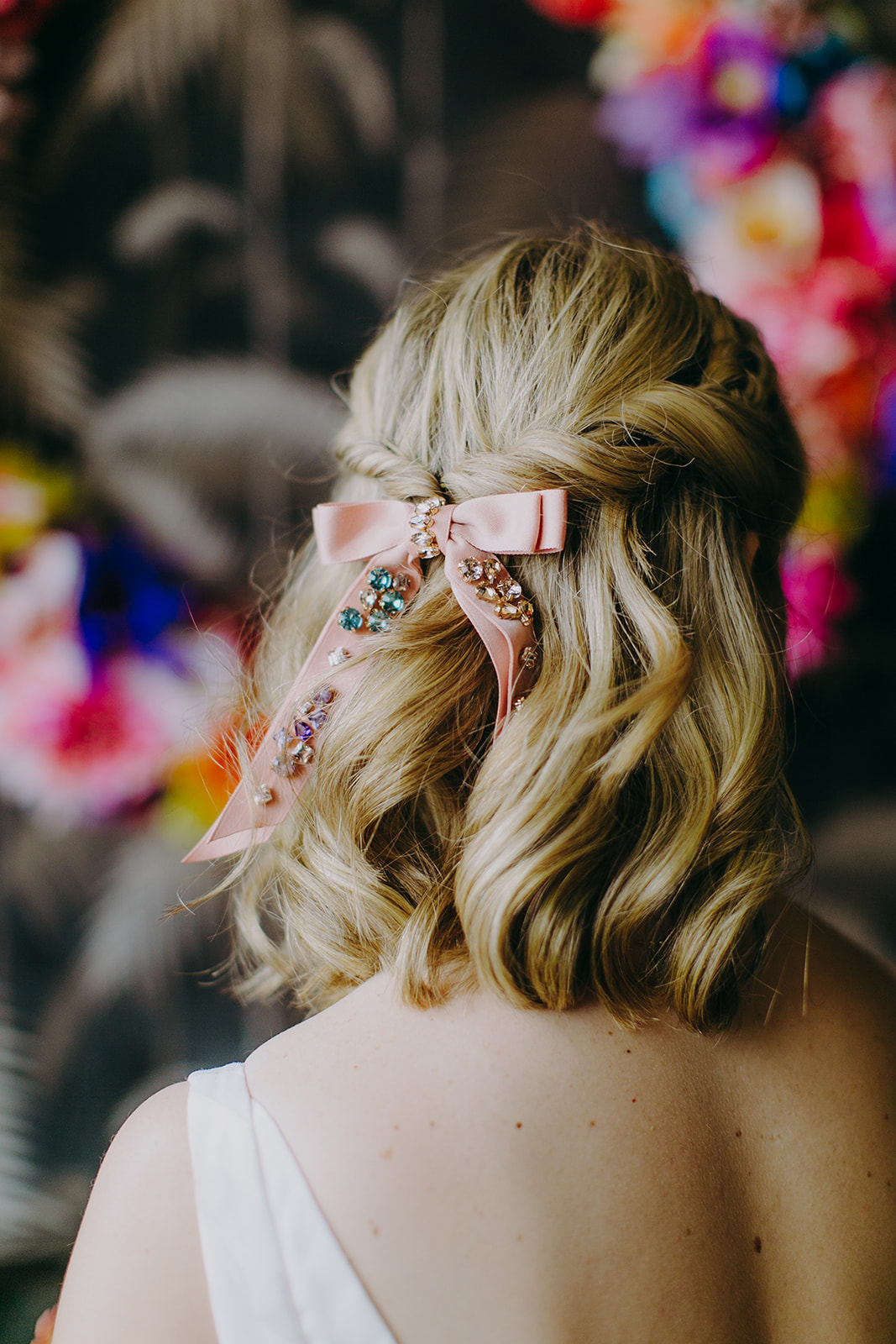 Bride with softly waved blonde hair and custom jeweled hair down on her wedding day in Brooklyn