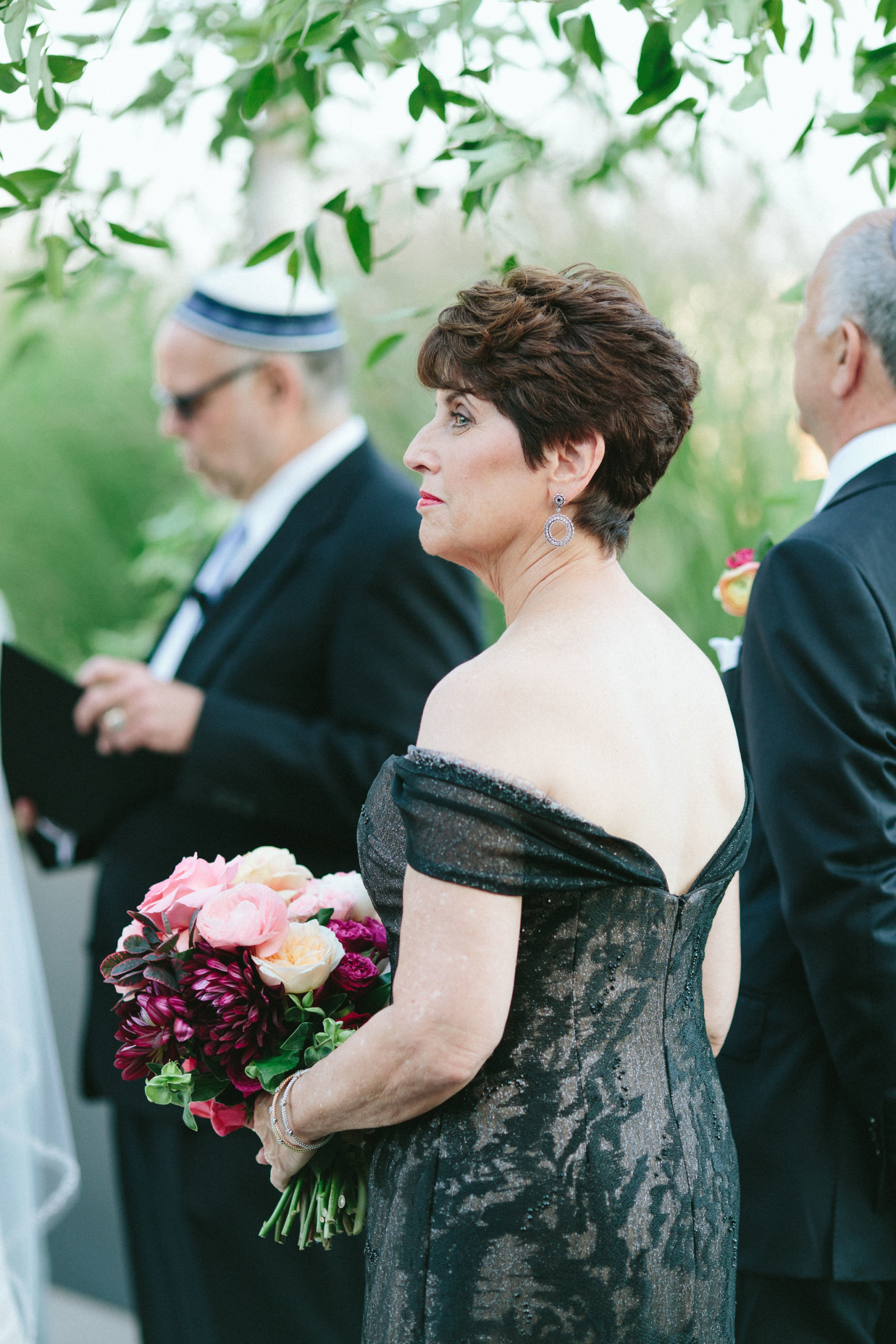 Beautiful mother-of-the-bride with short hair blown out and styled at Tribeca Rooftop in New York City
