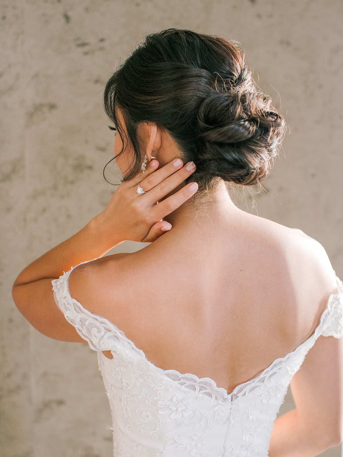 Bride with modern and elegant soft updo on wedding day