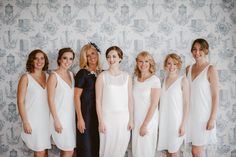 Bride, bridesmaids, and moms with varied makeup and hair pose at the Wythe Hotel in Williamsburg, Brooklyn
