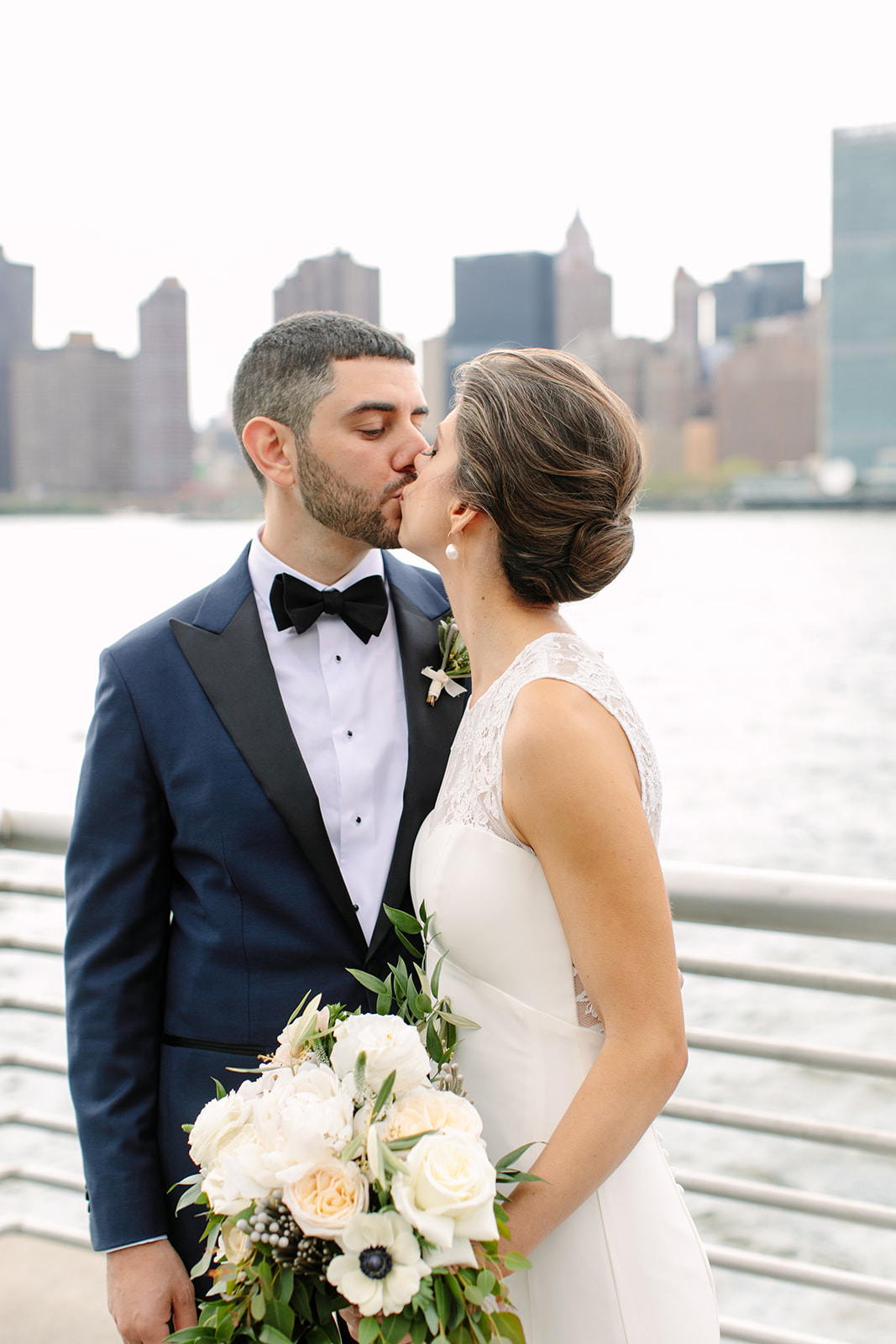 Bride with modern, chic chignon pictured in Brooklyn