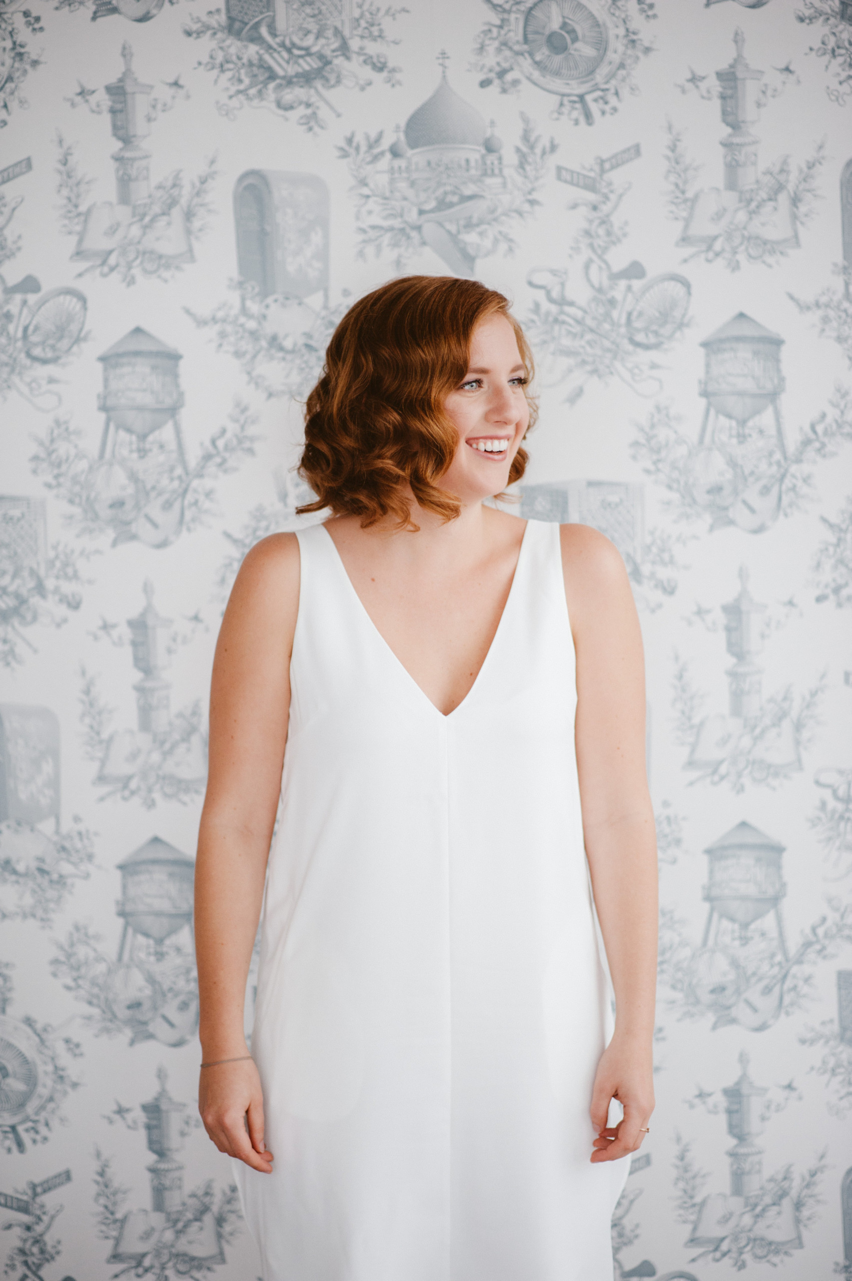 Bridesmaid with red hair styled in modern Hollywood wave at the Wythe Hotel