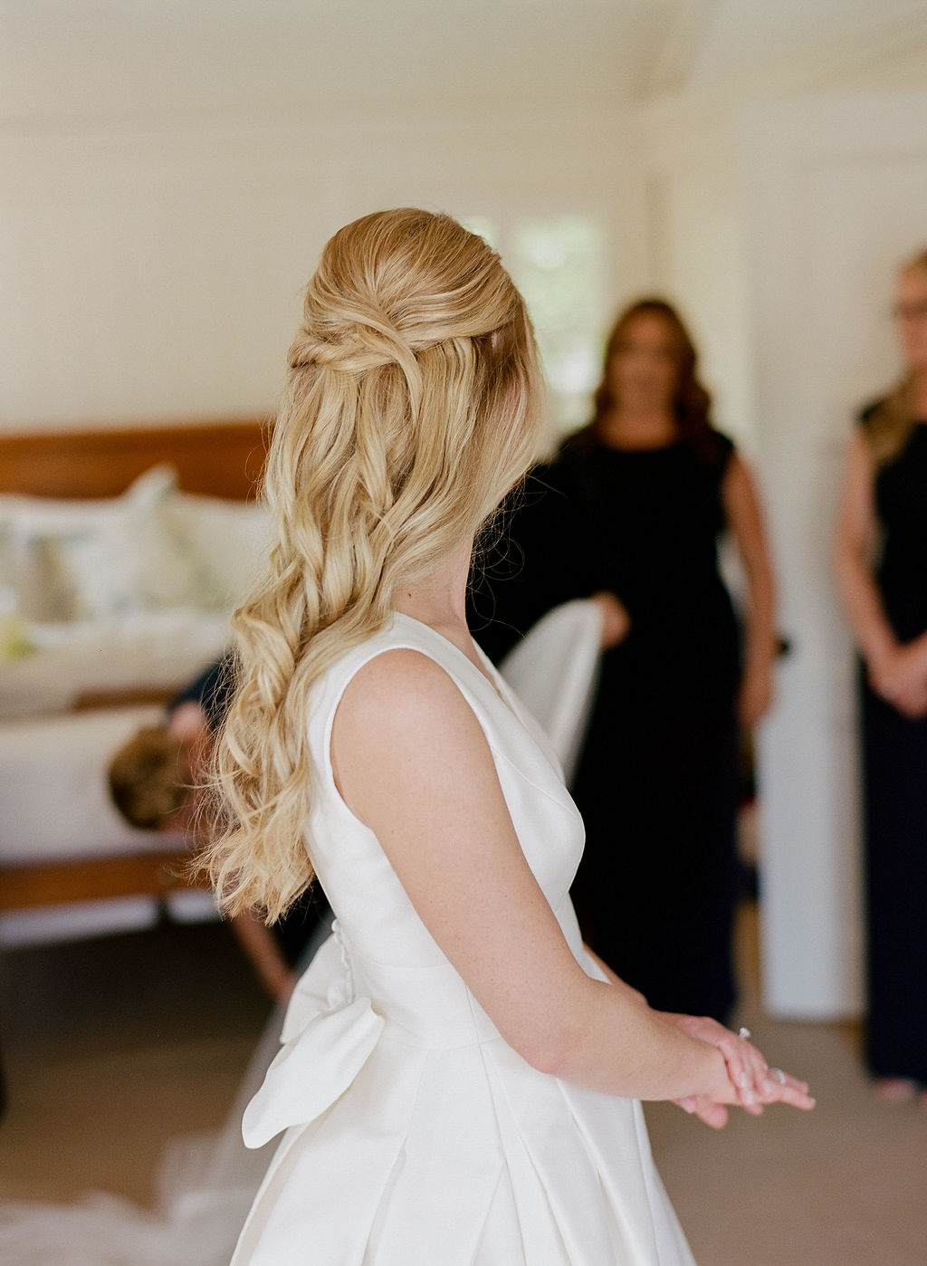 Blonde bride with very long hair and highlights with hair pulled half back off of her face, pictured at the Harborview Hotel in Edgartown, Martha's Vineyard, MA