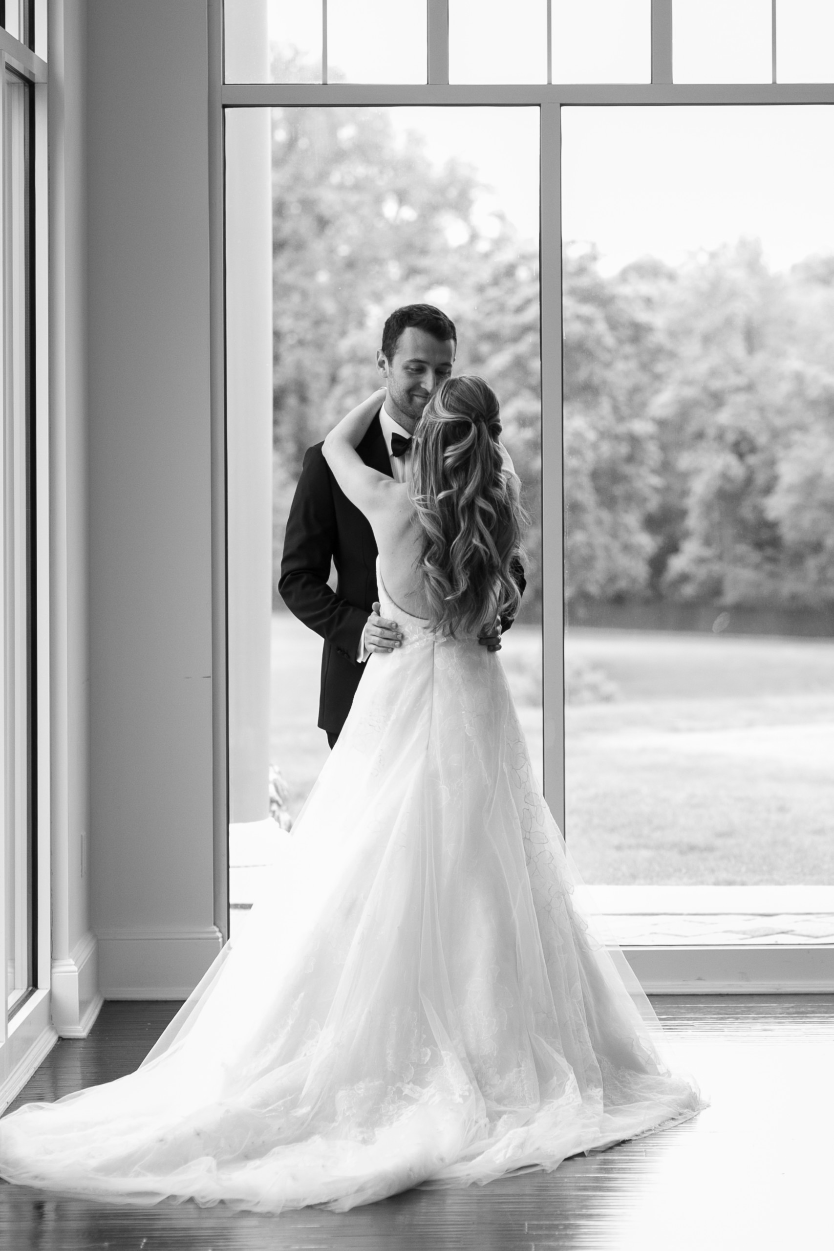 Bride with very long, highlighted hair that is waved and pulled half back off of her face pictured at Stonebridge Country Club