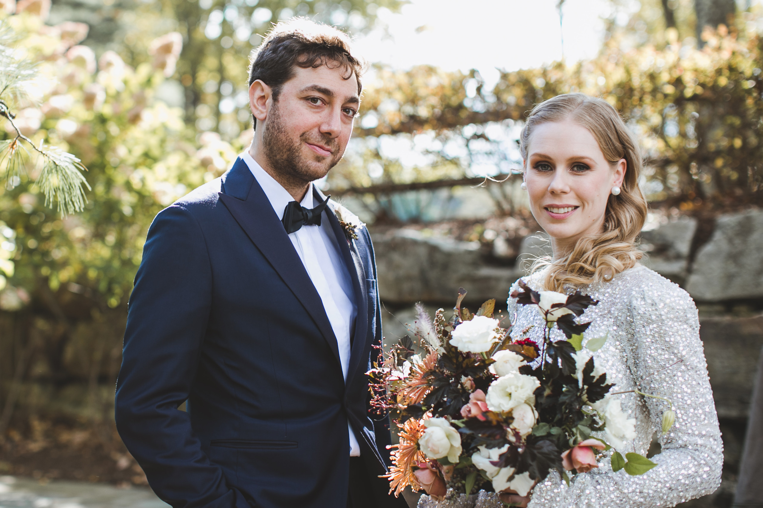 Blonde bride with hair styled in Hollywood waves greets her groom at Cedar Lakes Estate