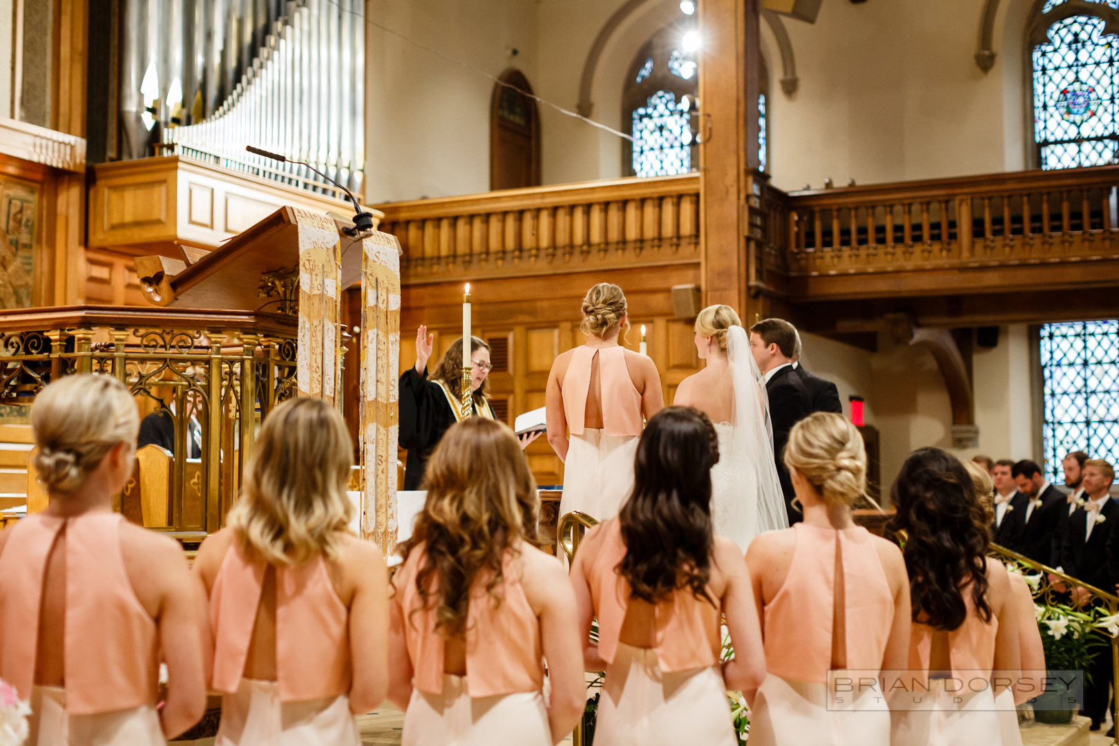 six bridesmaids with a variety of styled hair support their bride at cathedral in New York City
