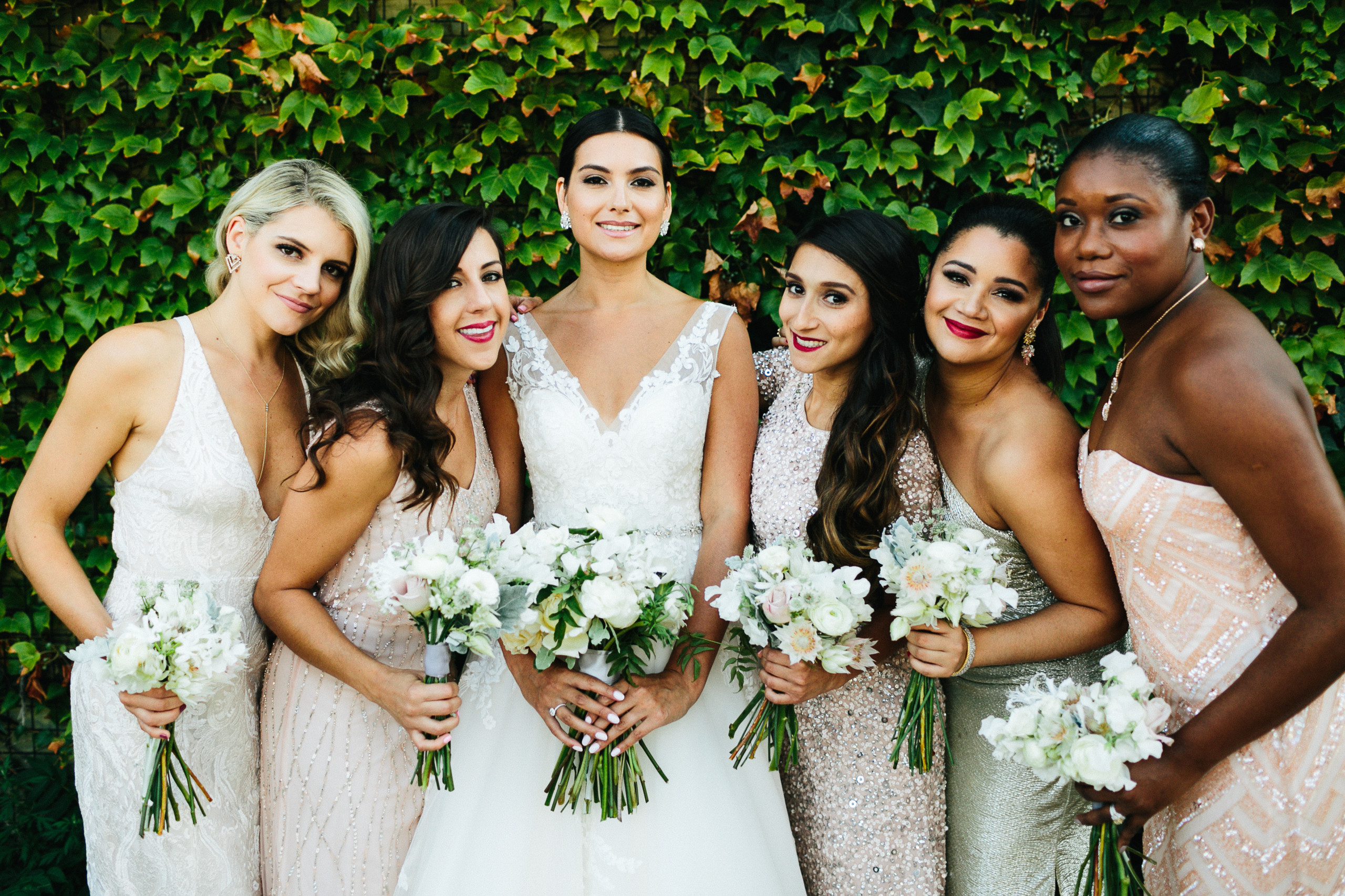 Bride with her multi-cultural bridesmaids at 501 Union in Brooklyn