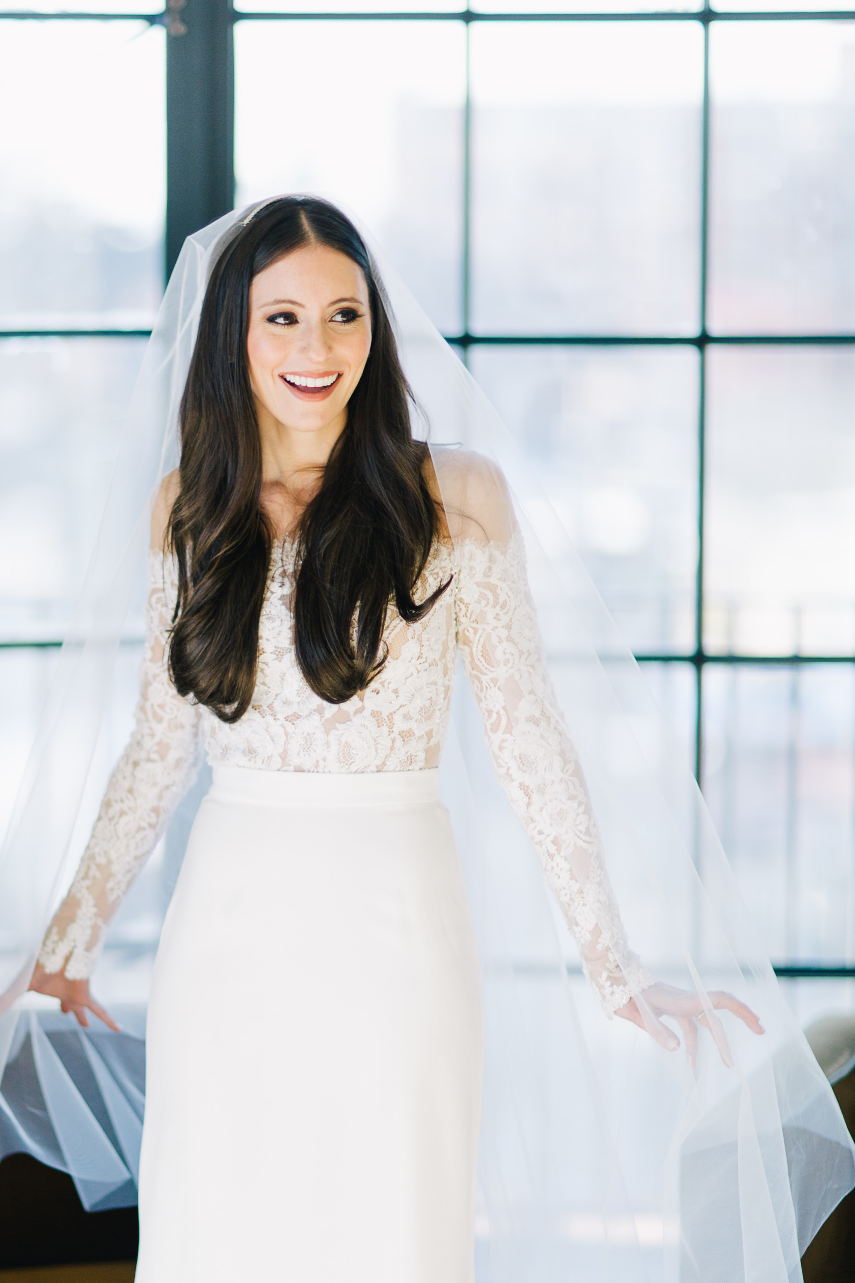 Winter bride with dark eyeliner and perfect skin poses at Bowery Hotel before her ceremony