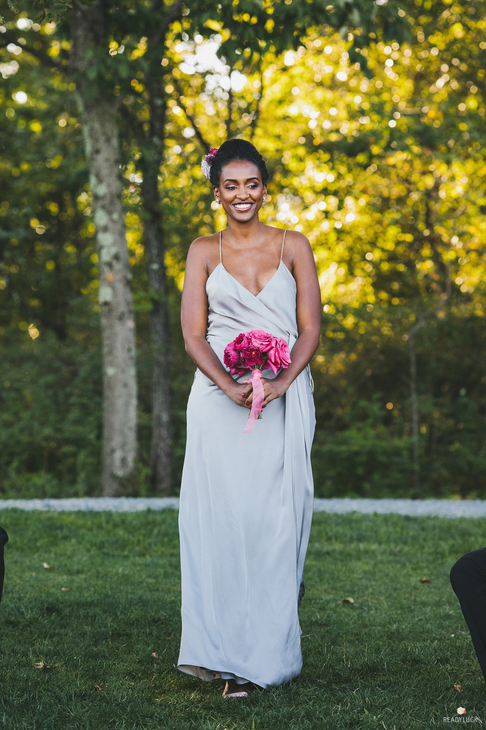 Stunning bridesmaid in glamorous makeup and grey silk gown was down the aisle at Cedar Lakes Estate