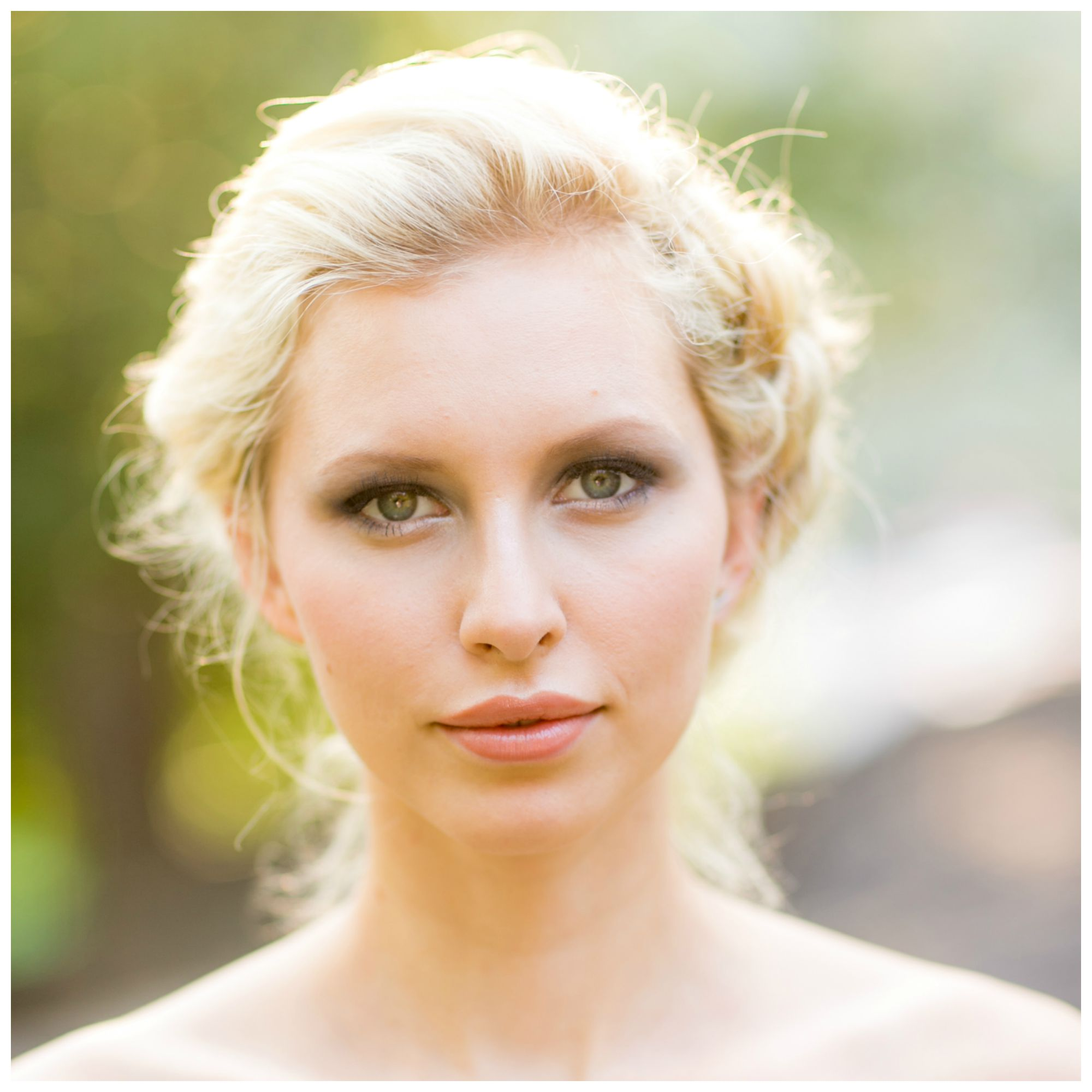 Blonde bride with big blue eyes, smokey grey shadows and soft pink lips, shot in Central Park