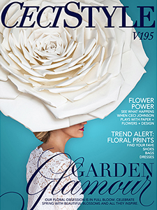 Ceci Johnson posing on the cover of her magazine in enormous paper hat and strong lipstick