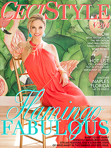 Ceci Johnson posing in bright coral with bronzy makeup on the cover of her magazine