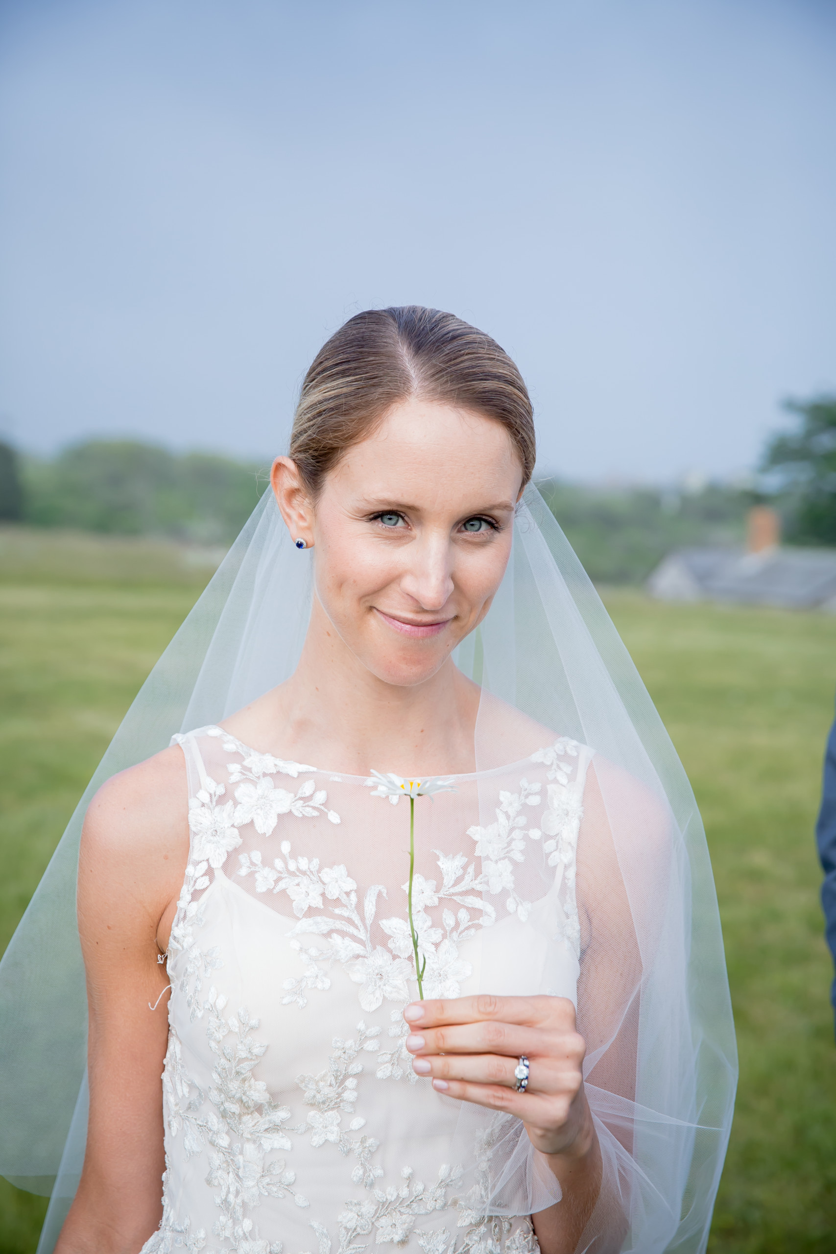 Bride with perfect skin and very natural makeup poses after her ceremony at the Allen Farm in Chilmark, Martha's Vineyard, MA