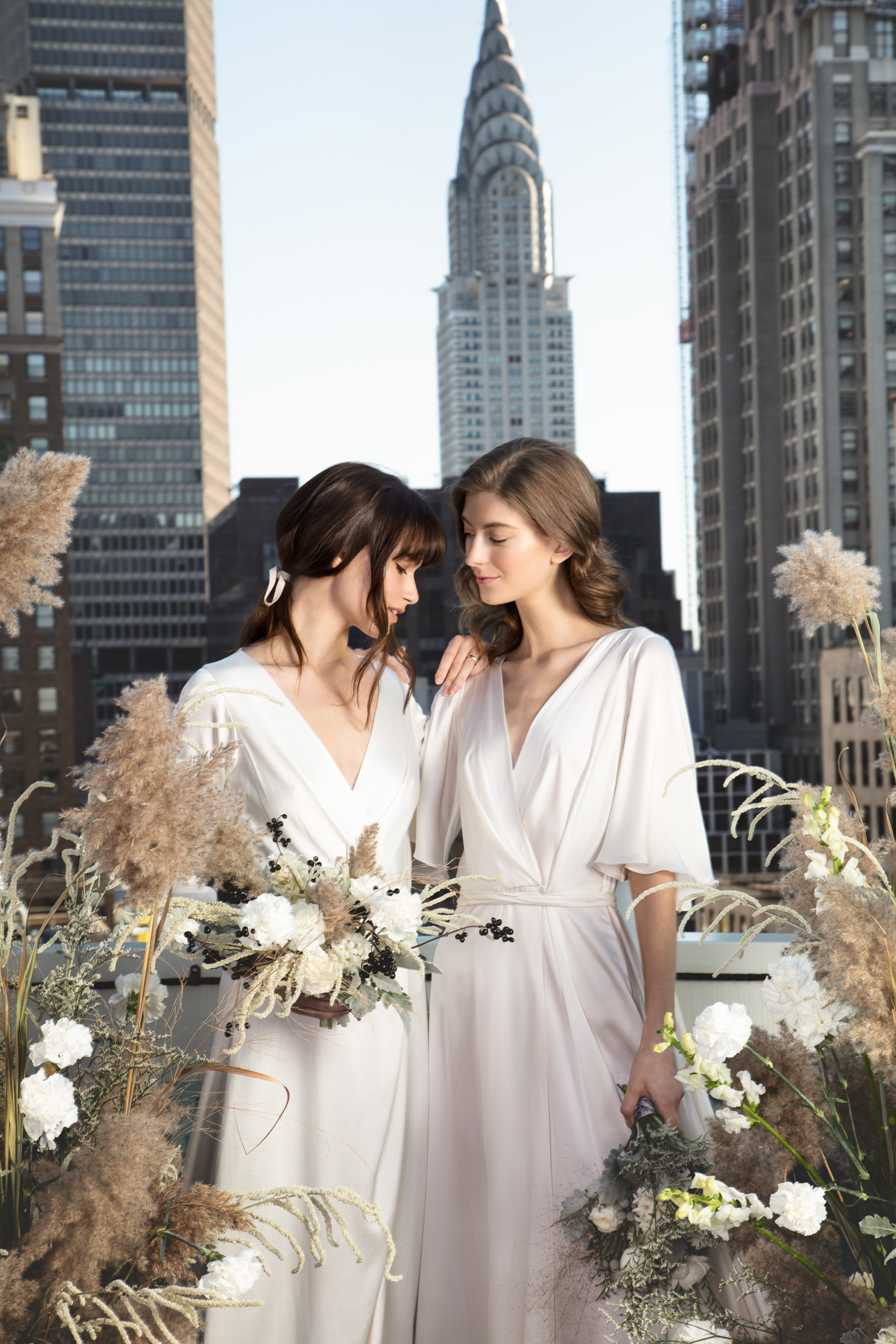 Two brides posing at their wedding at Sofitel in New York City