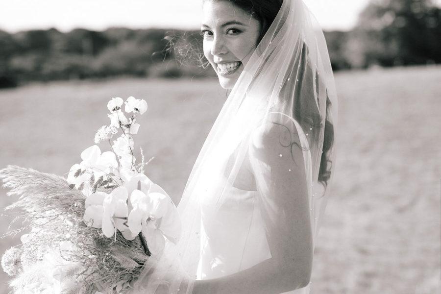bride in veil with flowers in Martha's Vineyard